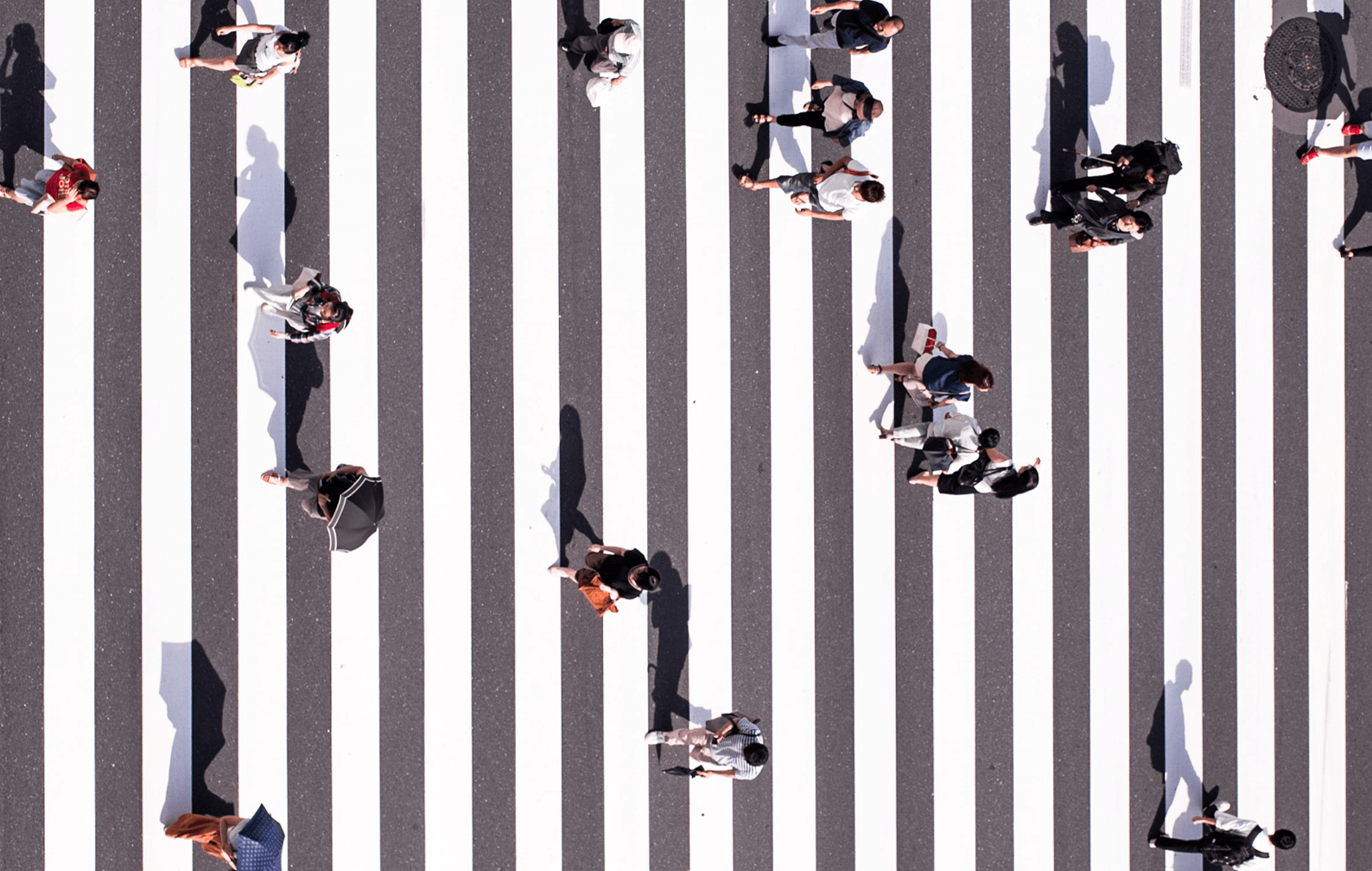 People crossing the road in different directions