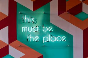 "Neon letters that spell ""This must be the place"""