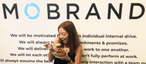 Sara eating quinoa bowl